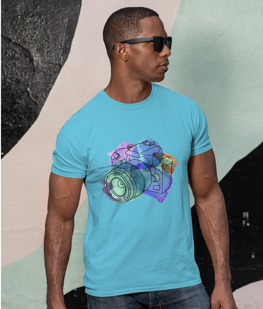 Mockup of a man with sunglasses wearing a customizable t shirt against a painted wall 30447
