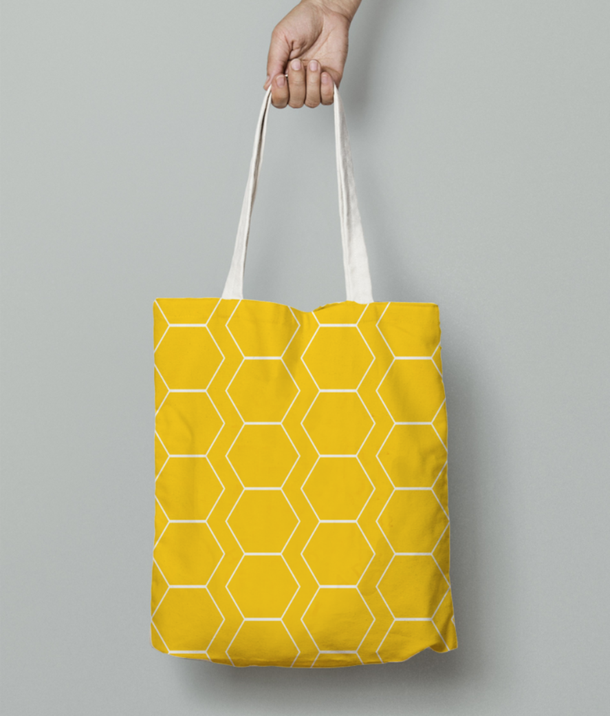 Yellow white hexagon pattern tote bag front