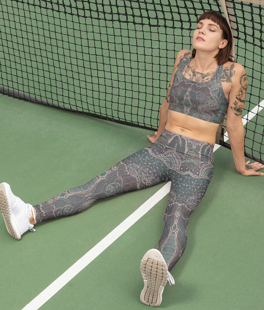 Sports bra mockup of a woman with leggings resting in a tennis court 28729